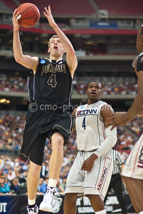 Mar 26, 2009; Tucson, AZ, USA; Purdue Boilermakers forward Robbie Hummel (4) goes up for a layup in front of Connecticut Huskies forward Jeff Adrien (4) in the first half of a game in the semifinals of the west region of the 2009 NCAA basketball tournament at University of Phoenix Stadium.