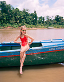 PERU, Amazon Rainforest, South America, Latin America, portrait of Nell on a boat in the Tambopata River.