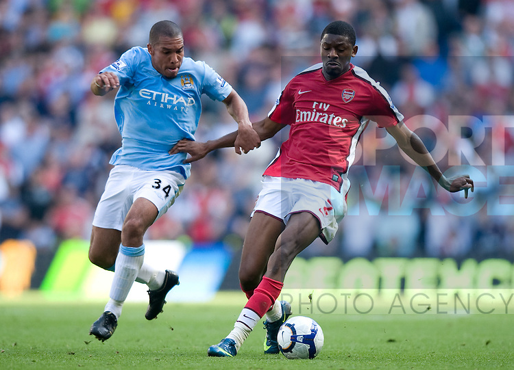 Nigel De Jong of Manchester City challenges Vassiriki Diaby of Arsenal