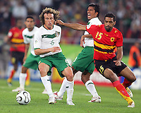 Gerardo Torrado (6) of Mexico slips the ball away from Rui Marques (15) of Angola as Pavel Prado (8) shouts instructions. Mexico and Angola played to a 0-0 tie in their FIFA World Cup Group D match at FIFA World Cup Stadium, Hanover, Germany, June 16, 2006.