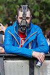 "© Joel Goodman - 07973 332324 . No syndication permitted . 26/08/2013 . Bolton , UK . An English Defence League protester wearing a "" Bane "" facemask at the demonstration The English Defence League hold a demonstration in Farnworth Park , Bolton , today (26th August 2013) . Photo credit : Joel Goodman"