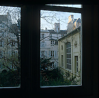 A view of the Parisian cityscape in winter framed by one of the windows of the former atelier of Eugene Delacroix now a museum devoted to his work