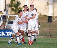 Andrew Oliver (16) of the USA celebrates his goal with teammates Marc Pelosi (11) and Mobi Fehr (6) during the group stage of the CONCACAF Men's Under 17 Championship at Jarrett Park in Montego Bay, Jamaica. The USA defeated Panama, 1-0.