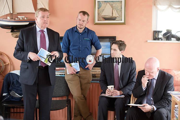 Pat Breen TD Chairman Oireachtas Committee on Foreign Affairs and Trade addresses the gathering watched by Padraig O Rourke, OPW, Simon Harris TD, Minister of State at the Departments of Finance, Public Expenditure and Reform and Frank Shalvey, OPW at Kilrush Marina. Photograph by John Kelly.