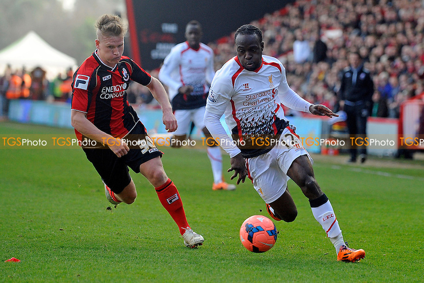 Victor Moses of Liverpool goes past Matt Ritchie of AFC Bournemouth - AFC Bournemouth vs Liverpool - FA Cup 4th Round Football at the Goldsands Stadium, Bournemouth, Dorset - 25/01/14 - MANDATORY CREDIT: Denis Murphy/TGSPHOTO - Self billing applies where appropriate - 0845 094 6026 - contact@tgsphoto.co.uk - NO UNPAID USE