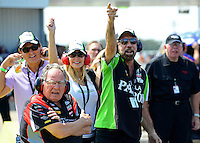 Sept. 22, 2012; Ennis, TX, USA: John Paul DeJoria (right) and Connie Kalitta (left) watch as NHRA funny car driver Alexis DeJoria (not pictured) goes down the track during qualifying for the Fall Nationals at the Texas Motorplex. Mandatory Credit: Mark J. Rebilas-US PRESSWIRE