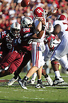 South Carolina Gamecocks safety Antonio Allen (26) puts the hit on Alabama Crimson Tide quarterback Greg McElroy (12). South Carolina leads 21 over Alabama 9 at  the half.