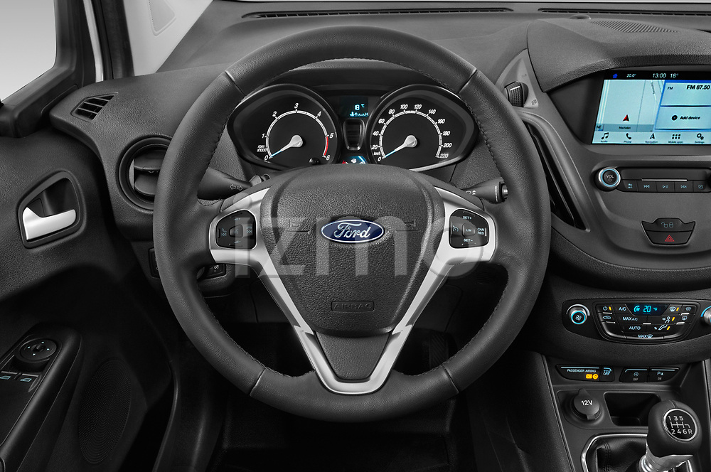 Car pictures of steering wheel view of a 2018 Ford transit courier Limited 4 Door Car Van