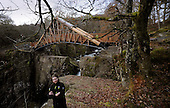 Pic shows Project Manager Kenny Auld under the new Bracklinn Falls Bridge, near Callander, which opens tomorrow (Tues 16th). The popular walking spot at Bracklinn Falls has been without a bridge since flash floods washed away the original bridge in 2004. Loch Lomond & The Trossachs National Park has worked with Callander Community Development Trust to replace the bridge. The rural location of the site made it impossible to use traditional installations methods including crane and helicopter options. A team of two contractors had to winch the 20 metre steel and timber structure into place by hand. The bridge has a distinct copper roof and is designed using locally sourced Larch and four Douglas Fir tree trunks each measuring 12 metres long. It weighs 20 tonnes and took over 3,000 man hours to install, at a cost of £110,000. Project Manager Kenny Auld (in some pics) is on 07740073286 - picture by Donald MacLeod 15.11.10 - mobile 07702 319 738 - clanmacleod@btinternet.com - www.donald-macleod.com