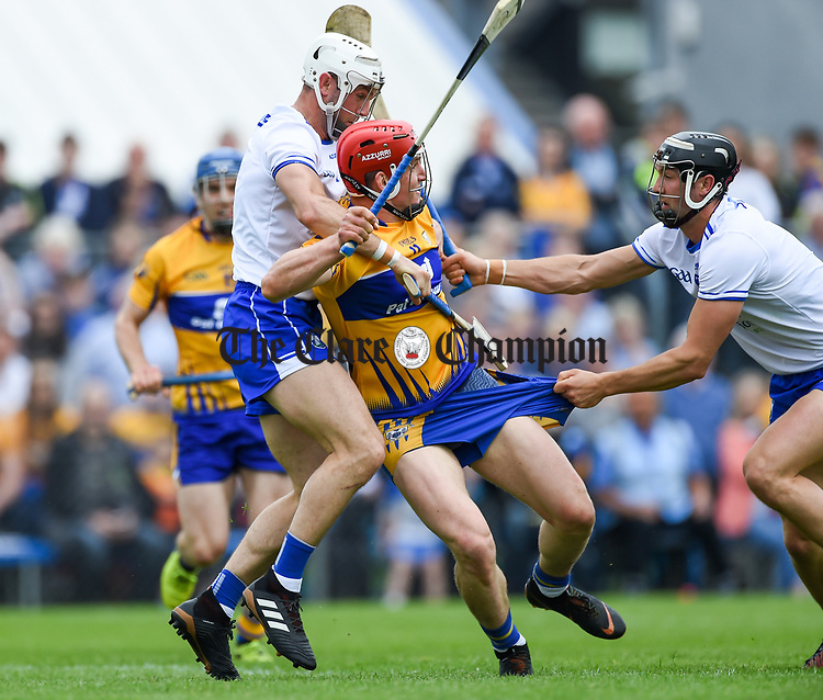 John Conlon of Clare is fouled for a penalty by Shane Fives and Darragh Fives of Waterford during their Munster  championship round robin game at Cusack Park Photograph by John Kelly.