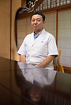 Hiroshi Ishikawa, who runs Hokushu Kurabu, poses for  photo at his restaurant Odate, Akita Prefecture Japan. The restaurant has served the dish for well over a century. Photographer: Rob Gilhooly