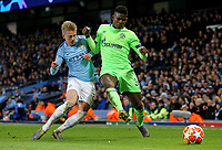 FC Schalke 04&rsquo;s Breel Embolo vies for possession with  Manchester City's Oleksandr Zinchenko<br /> <br /> Photographer Rich Linley/CameraSport<br /> <br /> UEFA Champions League Round of 16 Second Leg - Manchester City v FC Schalke 04 - Tuesday 12th March 2019 - The Etihad - Manchester<br />  <br /> World Copyright &copy; 2018 CameraSport. All rights reserved. 43 Linden Ave. Countesthorpe. Leicester. England. LE8 5PG - Tel: +44 (0) 116 277 4147 - admin@camerasport.com - www.camerasport.com