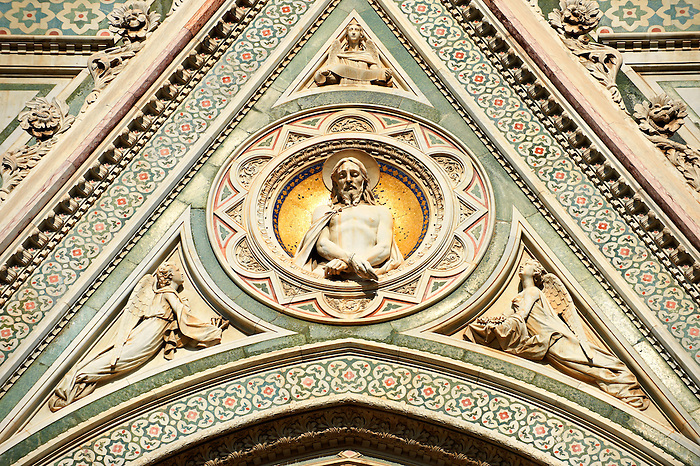 The tondo relief of Christ with his hands tied on central door of the fine Gothic architectural detail  of  the  of the Gothic-Renaissance Duomo of Florence,  Basilica of Saint Mary of the Flower; Firenza ( Basilica di Santa Maria del Fiore ).  Built between 1293 & 1436. Italy