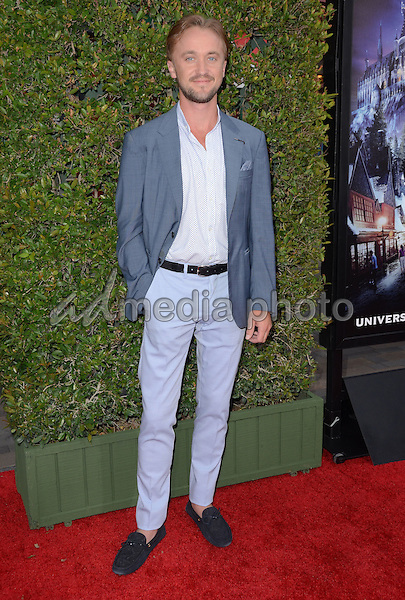 "05 April 2016 - Universal City, California - Tom Felton. Arrivals for Universal Studios' ""Wizarding World of Harry Potter Opening"" held at Universal Studios Hollywood. Photo Credit: Birdie Thompson/AdMedia"