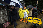 © Joel Goodman - 07973 332324 . 28/03/2015 . Manchester , UK . Labour stunt in the queue for the Conservative Party Spring Forum at the Old Granada Studios , Quay Street , Manchester , with Labour Party activists dressed as chickens and mocking David Cameron for not taking part in a direct TV debate with Ed Miliband . Photo credit : Joel Goodman