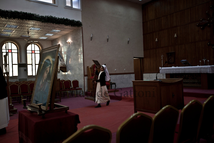 Iraq - Kurdistan - Ankawa - Sister preparing St Joseph Cathedral for the mass.