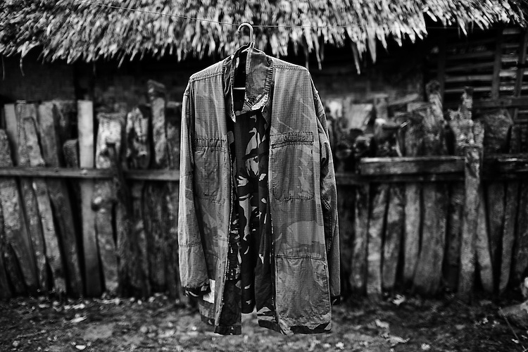 "Beyond the Bullets - Ceasefire..The jacket of an Armed Forces of the Philippines (AFP) soldier hangs drying in the camp of the 7th Infantry Battalion in Southern Mindanao on February 25, 2009.  Though the AFP and the Moro Islamic Liberation Front (MILF) currently have a ceasefire agreement, the AFP classifies its current movements as a ""police action"", as the rogue MILF commanders they are searching for attacked Christian communities in August when peace talks broke down."