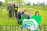Colm Cooper pictured with Patrick Crehan, Ellie O'Connor, Winona Carey, Darragh O'Donoghue, Michael O'Shea, Fiona Doyle and Emily Cronin, Cullina National School, as they raised their sixth green flag at the school on Friday. Also pictured is Sinead Sugrue, AIB, Killarney, who took part in a careers day at the school...................