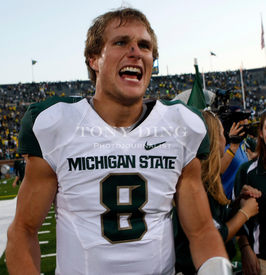 Michigan State quarterback Kirk Cousins (8) celebrates after an NCAA college football game with Michigan, Saturday, Oct. 9, 2010, in Ann Arbor. Michigan State won 34-17. (AP Photo/Tony Ding)