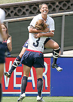 USA's Natasha Kai celebrates with Christie Rampone (3) after scoring a goal during a 5-0 victory over Ireland in San Diego, California, Sunday, July 23, 2006.