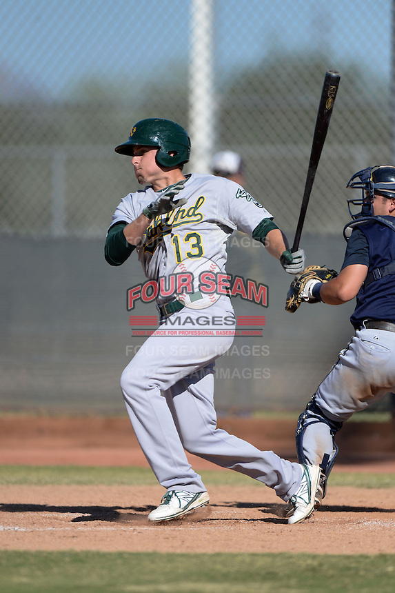 Oakland Athletics outfielder Mitchell Marincov (13) during an Instructional League game against the Milwaukee Brewers on October 10, 2013 at Maryvale Baseball Park Training Complex in Phoenix, Arizona.  (Mike Janes/Four Seam Images)