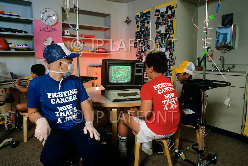 Houston, Texas - July 13, 1984. A patients play the Pac-Man inspired Killer T-Cell video game, designed by Dr. Elton Stubblefield, at the Anderson Hospital. This game was designed for young patients who suffer from cancer, and it simulates the reaction of chemotherapy to the tumor cells inside the body.