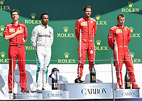 Claudio Albertini of Scuderia Ferrari, LEWIS HAMILTON (GBR) of Mercedes-AMG Petronas Motorsport, SEBASTIAN VETTEL (GER) of Scuderia Ferrari and KIMI RÄIKKÖNEN (FIN) of Scuderia Ferrari on the podium during The Formula 1 2018 Rolex British Grand Prix at Silverstone Circuit, Northampton, England on 8 July 2018. Photo by Vince  Mignott.
