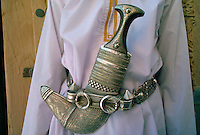 Close up detail of a khanjar traditional Arab knife with silver decoration and ram's horn hilt in Nizwa, Oman RESERVED USE - NOT FOR DOWNLOAD -  FOR USE CONTACT TIM GRAHAM