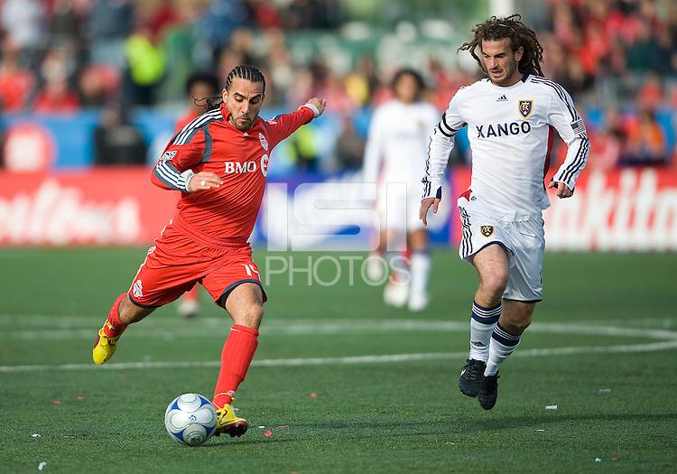 17 October 2009: Toronto FC midfielder Dewayne DeRosario #14 and Real Salt Lake midfielder Kyle Beckerman #5 in action during an MLS game between Toronto FC and Real Salt Lake at BMO Field in Toronto..Toronto FC won 1-0..