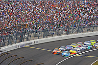 Aric Almirola (#43) and Kyle Busch, (#18) lead the field back to the green flag.