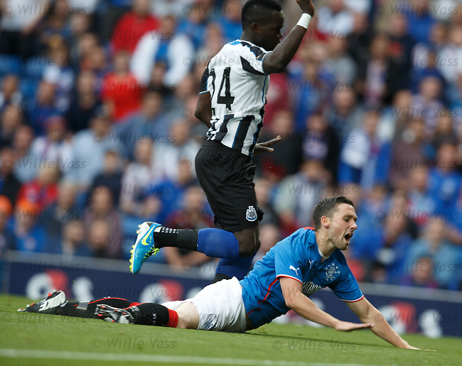 Nicky Clark fouled by Cheik Tiote for a penalty
