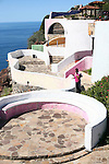 "Couple walk along colorful walkway as they look out upon the Pacific Ocean. Spanish is ""El Mirador"" for the ""Lookout"".<br />