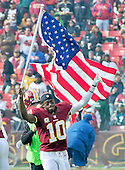 Washington Redskins quarterback Robert Griffin III (10) carries an American Flag during the pre game introductions for the game against the Philadelphia Eagles at FedEx Field in Landover, Maryland on Sunday, November 18, 2012..Credit: Ron Sachs / CNP