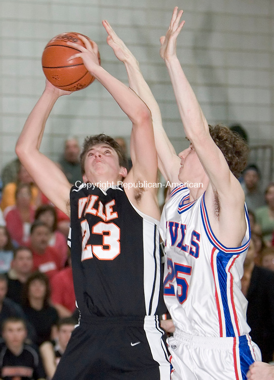 ROCKY HILL, CT- 13 MARCH 07- 031207JT15- <br /> Terryville's Brandon Marenna aims for a shot under pressure from Coginchaug's Joseph Davis during Monday's Class S quarterfinal game at Rocky Hill High School. Terryville lost 70-58.<br /> Josalee Thrift Republican-American