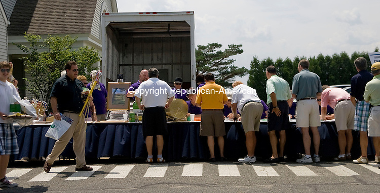 GOSHEN, CT - 12 JULY 2010 -071210JT04-<br /> Golfers register and receive gifts for participating in the 22nd Annual Torrington Rotary Charitable Golf Tournament on Monday at the Torrington Country Club in Goshen. All profits made will be sent to charities by the Torrington Rotary Club. <br /> Josalee Thrift Republican-American
