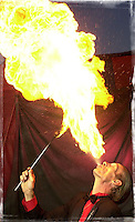 """Mephisto, the fire breather who declined to give his real name, one of the traveling performers in the World of Wonders at their last stop at the the Pensacola Interstate Fair in Pensacola, Florida. The troupe is ending its final touring season Sunday at the Pensacola Interstate Fair marking the end of an era of American folk art, according to carnival historians. """"Their just aren't any others left, """" said Fred Dahlinger, director of collections and research at the Circus World Museum in Baraboo, Wis. (AP Photo/Michael Spooneybarger/Pensacola News Journal)"""