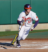 First baseman Jon McGibbon (12) of the Clemson Tigers in a game against the Wofford Terriers on Wednesday, March 6, 2013, at Doug Kingsmore Stadium in Clemson, South Carolina. Clemson won, 9-2. (Tom Priddy/Four Seam Images)
