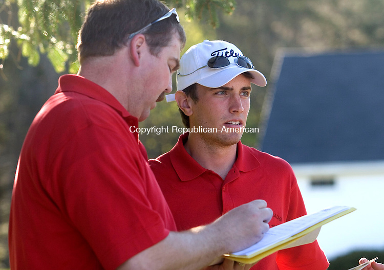 SOUTHBURY, CT - 03 MAY 2007 - 050307JW07.jpg -- Pomperaug Head Coach Rich Szymanski goes over the scores with Sam Pelletier Thursday afternoon at Heritage Village Golf course. Pomperaug defeated Bethel 150-215. Jonathan Wilcox Republican-American