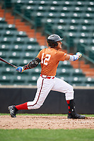Enmanuel Estrella (12) follows through on a swing during the Dominican Prospect League Elite Underclass International Series, powered by Baseball Factory, on July 21, 2018 at Schaumburg Boomers Stadium in Schaumburg, Illinois.  (Mike Janes/Four Seam Images)