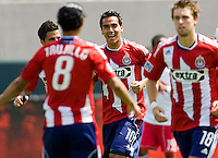 Chivas USA players congratulate midfielder teammate Jesus Padilla (10) as after scoring a goal. Chivas USA defeated the Red Bulls of New York 2-0 at Home Depot Center stadium in Carson, California April 10, 2010.  .