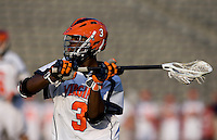 Rhamel Bratton (3) of Virginia looks for a teammate during the ACC men's lacrosse tournament semifinals in College Park, MD.  Virginia defeated Duke, 16-12.