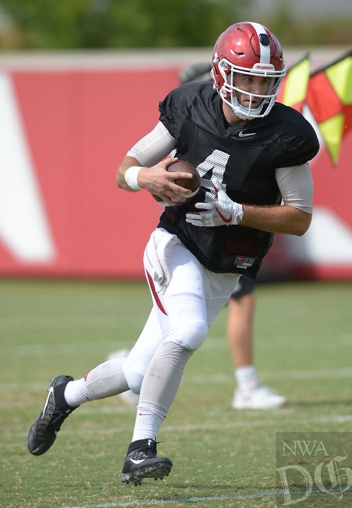 NWA Democrat-Gazette/ANDY SHUPE<br /> Arkansas quarterback Ty Storey carries the ball Thursday, Aug. 9, 2018, during practice at the university's practice facility in Fayetteville. Visit nwadg.com/photos to see more photos from practice.