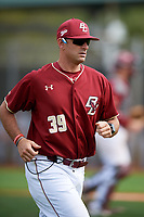 Boston College Eagles pitching coach Alex Trezza (39) jogs off the field after a mound meeting during a game against the Minnesota Golden Gophers on February 23, 2018 at North Charlotte Regional Park in Port Charlotte, Florida.  Minnesota defeated Boston College 14-1.  (Mike Janes/Four Seam Images)