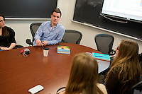 Group leader Aaron Pinet (junior) speaks with other students in  NASE402 Science in Environmental Policy course in Waltham, Massachusetts, USA.  The class involves an optional extra section that includes a trip to Washington, D.C., for these students to meet with policy makers and discuss the role of science in making government policy.