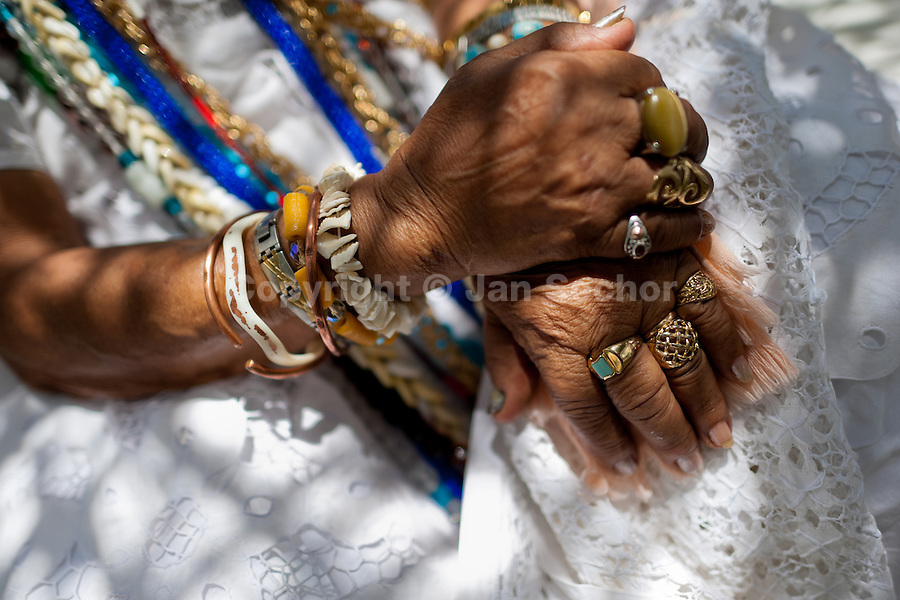 Hands of a priestess of Candomblé (Mãe-de-santo, iyalorishá) seen during the ritual ceremony in honor to Yemanjá, the goddess of the sea, in Cachoeira, Bahia, Brazil, 5 February 2012. Yemanjá, originally from the ancient Yoruba mythology, is one of the most popular ?orixás?, the deities from the Afro-Brazilian religion of Candomblé. Every year on February 5th, hundreds of Yemanjá devotees participate in a colorful celebration in her honor. Faithful, usually dressed in the traditional white, gather on the banks of Paraguaçu river to leave offerings for their goddess. Gifts for Yemanjá include flowers, perfumes or jewelry. Dancing in the circle and singing ancestral Yoruba prayers, sometimes the followers enter into a trance and become possessed by the spirits. Although Yemanjá is widely worshipped throughout Latin America, including south of Brazil, Uruguay, Cuba or Haiti, the most popular cult is maintained in Bahia, Brazil.