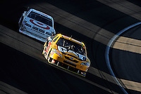 Mar 2, 2008; Las Vegas, NV, USA; NASCAR Sprint Cup Series driver Dave Blaney leads Dario Franchitti during the UAW Dodge 400 at Las Vegas Motor Speedway. Mandatory Credit: Mark J. Rebilas-US PRESSWIRE