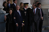 WASHINGTON, DC - DECEMBER 03: Former First Lady Laura Bush and Former President George W. Bush greet guests as the casket of former U.S. President George H.W. Bush arrives at the U.S Capitol on December 03, 2018 in Washington, DC. A state funeral for former U.S. President Bush will be held in Washington over the next three days, beginning with him lying in state in the Rotunda of the U.S. Capitol until Wednesday morning.  (Photo by Win McNamee - Pool/Getty Images)
