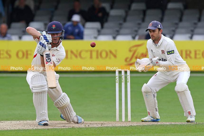 Luis Reece of Lancashire in batting action for  as James Foster looks on from behind the stumps during Essex CCC vs Lancashire CCC, Day Three