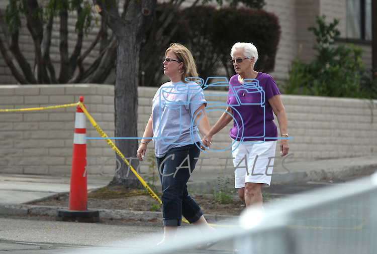 Kathy Chaney and her mother Ethlyn MacDonald walk outside the IHOP restaurant in Carson City, Nev., on Wednesday, Sept. 7, 2011. The two were with family members in the restaurant Tuesday when gunman Eduardo Sencion opened fire with an AK-47, killing four people and injuring seven others. (AP Photo/Cathleen Allison)