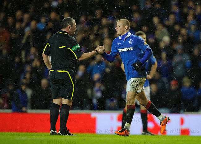 Vladimir Weiss gets a handshake from referee Brain Winter as he is subbed